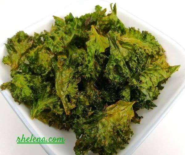 Crispy oven baked kale chips in a bow.