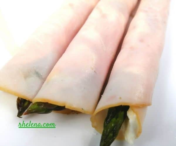 Deli turkey rollups shown with cream cheese and asparagus spears.