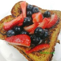 French toast shown with blueberries and strawberries.