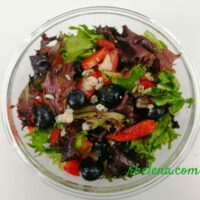 Salad with baby greens, berries and blue cheese.