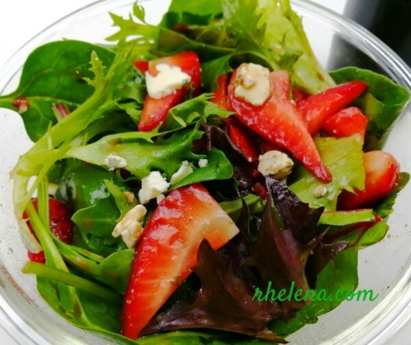 Salad with mixed greens and strawberries.
