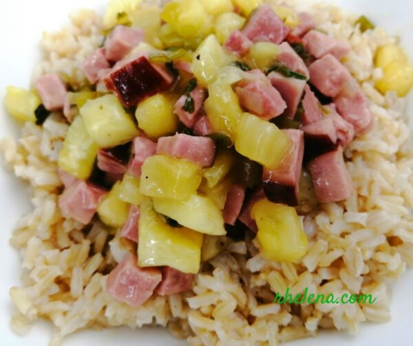 Ham and pineapple served over a bowl of rice.